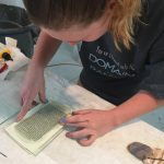 Sarah Afdeey working on a glass piece under the tutelage of Stephen Edwards.